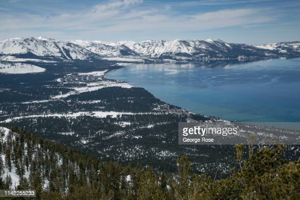The lake and snow covered mountains are viewed from the Heavenly Ski Resort observation deck on March 17 in South Lake Tahoe, California. Drought in...
