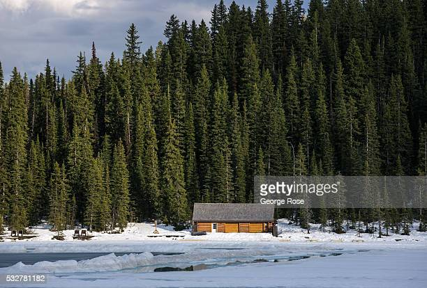 The Lake Louise boathouse is viewed on April 23 2016 at Lake Louise Alberta Canada Banff is Canada's oldest National Park and is located in the...
