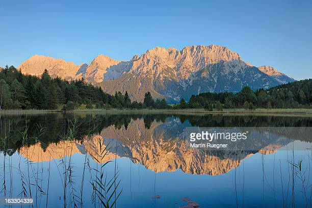 the lake luttensee with karwendel mountains. - karwendel mountains stock pictures, royalty-free photos & images