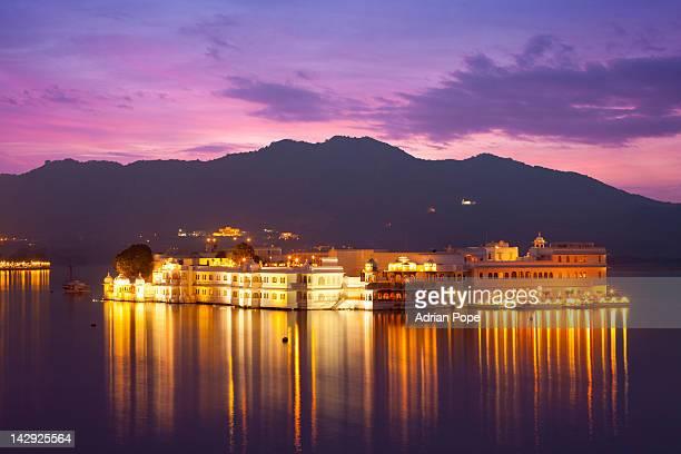 The Lake Palace Hotel illuminated at twilight