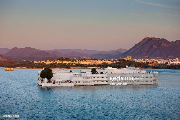 The Lake Palace Hotel Jag Niwas on island site on Lake Pichola in first light of early morning Udaipur Rajasthan India