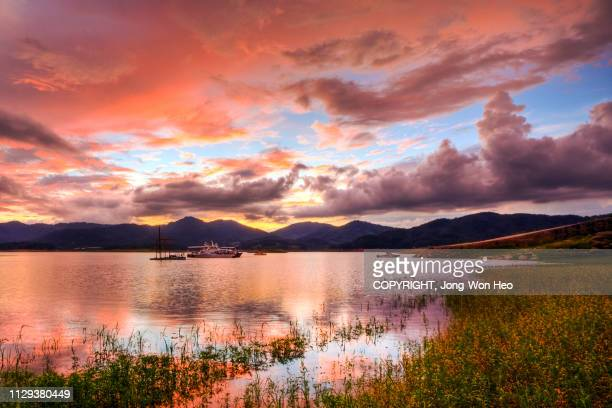 the lake which was colored by the beautiful sunset glow - high dynamic range imaging stock pictures, royalty-free photos & images