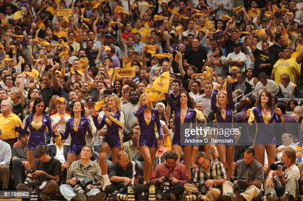 The Laker Girls and fans applaud the Los Angeles Lakers as they take on the San Antonio Spurs in the fourth quarter of Game One of the Western...