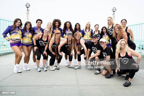 The Laker Girls pose for a picture at the 6th Annual Tour de Pier at Manhattan Beach Pier on May 20 2018 in Manhattan Beach California