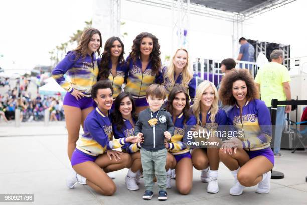 The Laker Girls pose for a picture wtih William Uniack at the 6th Annual Tour de Pier at Manhattan Beach Pier on May 20 2018 in Manhattan Beach...