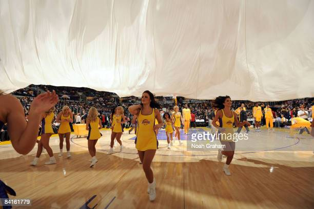 The Laker Girls run off the court before the introduction of the starting lineups prior to the game against the Utah Jazz at Staples Center on...
