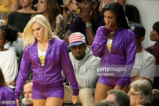 The Laker Girls walk in front of rapper Kanye West in Game Three of the 2008 NBA Finals between the Boston Celtics and the Los Angeles Lakers on June...