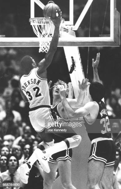 YEARS The Lakers Earvin 'Magic' Johnson drives to the basket to score against the Boston Celtics Larry Bird and Kevin McHale during the NBA Finals in...