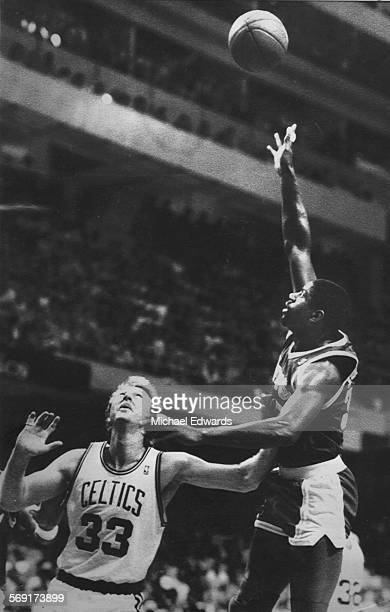 YEARS – The Lakers Earvin 'Magic' Johnson puts up a shot over the Celtics Larry Bird during NBA Championship game on June 11 1987