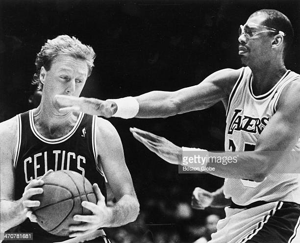 The Lakers' Kareem AbdulJabbar attempts to block the Celtics' Larry Bird during an NBA playoff game in June 1987 Exact date unknown