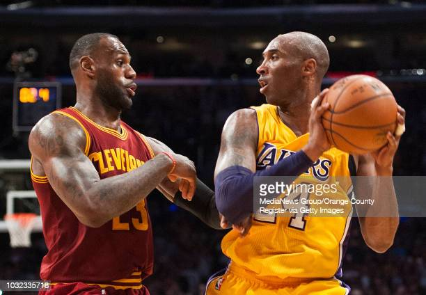 The Lakers' Kobe Bryant looks to shoot past the Cavaliers' Lebron James during their basketball game at Staples Center Thursday night INFO...