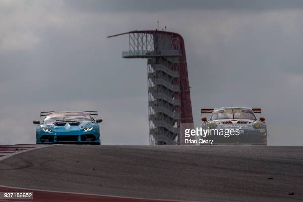 The Lamborghini Huracan Super Trofeo of Ryan Hardwick and Davide Amduzzi of Italy and the Porsche 911 GT3 R of Alec Udell and Mathieu Jaminet of...
