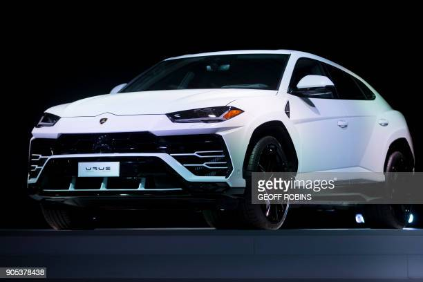 The Lamborghini Urus is unveiled at a press event alongside the 2018 North American International Auto Show Press Preview in Detroit Michigan January...