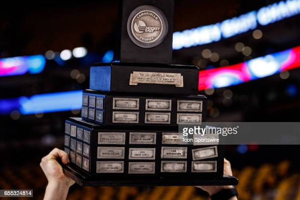 The Lamoriello Trophy overhead after the Riverhawks win the Hockey East Conference Championship game against the Boston College Eagles on March 18th...