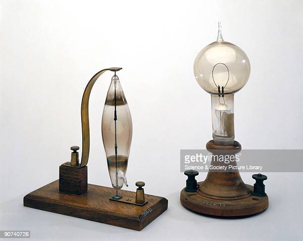 The lamp on the left is an early carbon and rod filament incandescent electric lamp made by the English chemist Joseph Swan in 18781879 The lamp on...