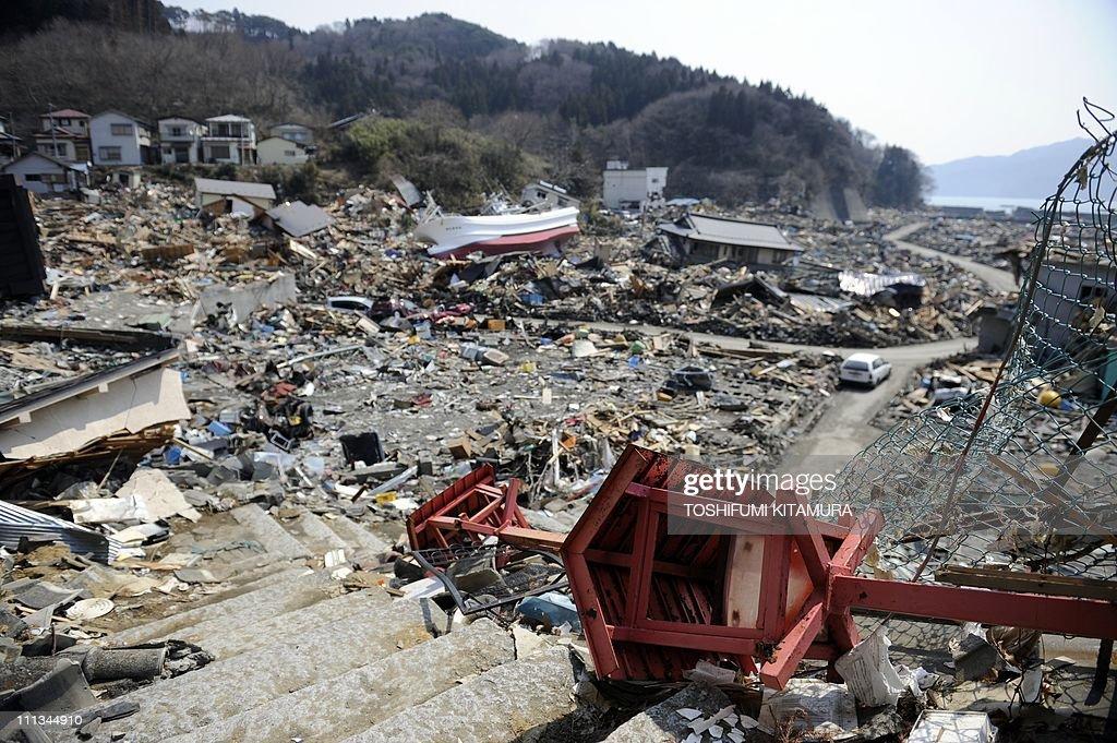The Lamp Posts Of The Otsuchi Inari Shrine Lie On The Floor Tsunami Rubble  At Otsuchi