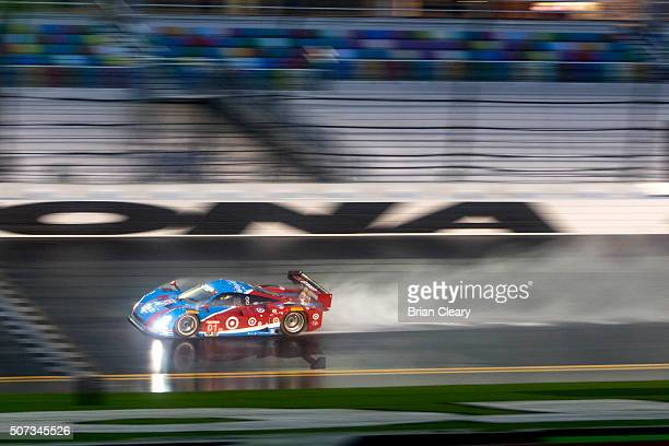 The Lance Stoll, Brendan Hartley, Alex Wurz and Andy Priaulx drives in the rain during qualifying for the Rolex 24 at Daytona at Daytona...