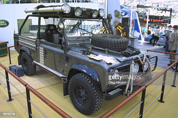 The Land Rover 'Defender' from the film 'Lara Croft Tomb Raider' is on display August 23 2001 at the International Moscow Motor Show in Moscow Russia