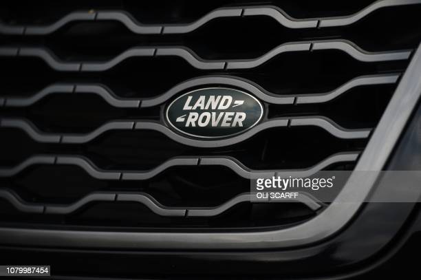 The Land Rover logo is seen on the front of a Range Rover car at a Land Rover dealership in Wakefield, northern England, on Janaury 10, 2019. -...