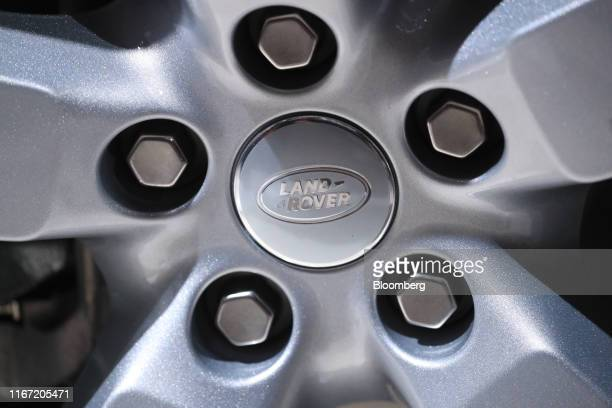 The Land Rover logo sits on the wheel hub of a new Land Rover Defender sports utility vehicle manufactured by Jaguar Land Rover Plc on the opening...