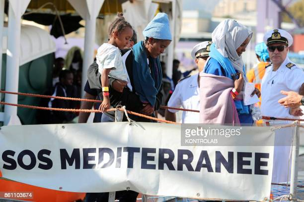 The landing of 600 migrants at the Port of Palermo by Aquarius ship mostly children In the picture the stages of landing from Aquarius ship