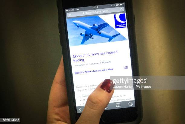 The landing page to Monarch Airlines website accessed on a mobile phone at Gatwick Airport The airline has collapsed into administration resulting in...