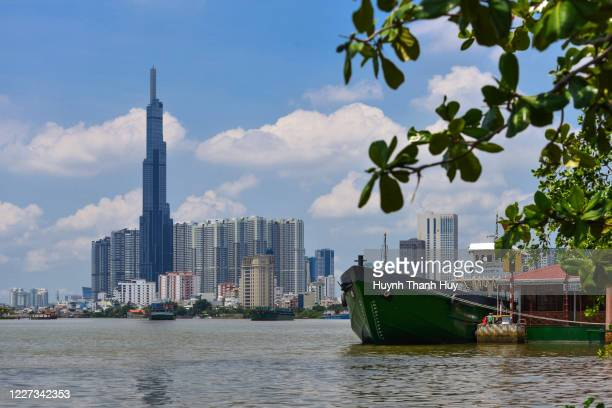the landmark 81 building by riveraide in binh thanh district - saigon river stock pictures, royalty-free photos & images