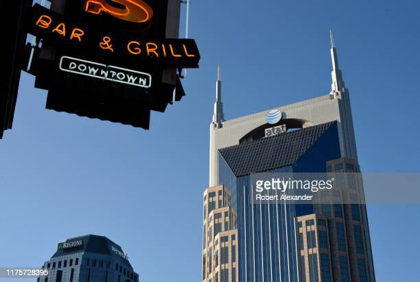 The landmark AT&T Building looms over the Lower Broadway entertainment district in Nashville, Tennessee. The 33-story skyscraper, often referred to...