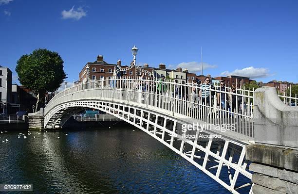 The landmark Ha'penny Bridge over the River Liffey in Dublin Ireland was built in 1816