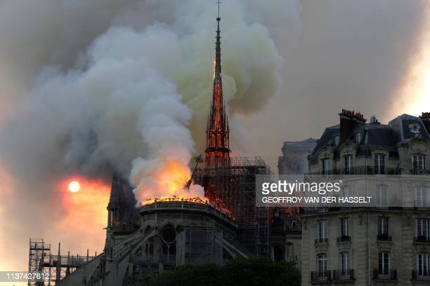 TOPSHOT The landmark NotreDame Cathedral engulfed in flames burns on April 15 in central Paris A huge fire swept through the roof of the famed...
