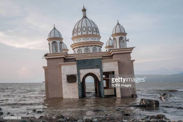 The Landmark of Arkam Babu Rahman Floating Mosque which fallen into the sea after the earthquake and tsunami A deadly earthquake measuring 77...