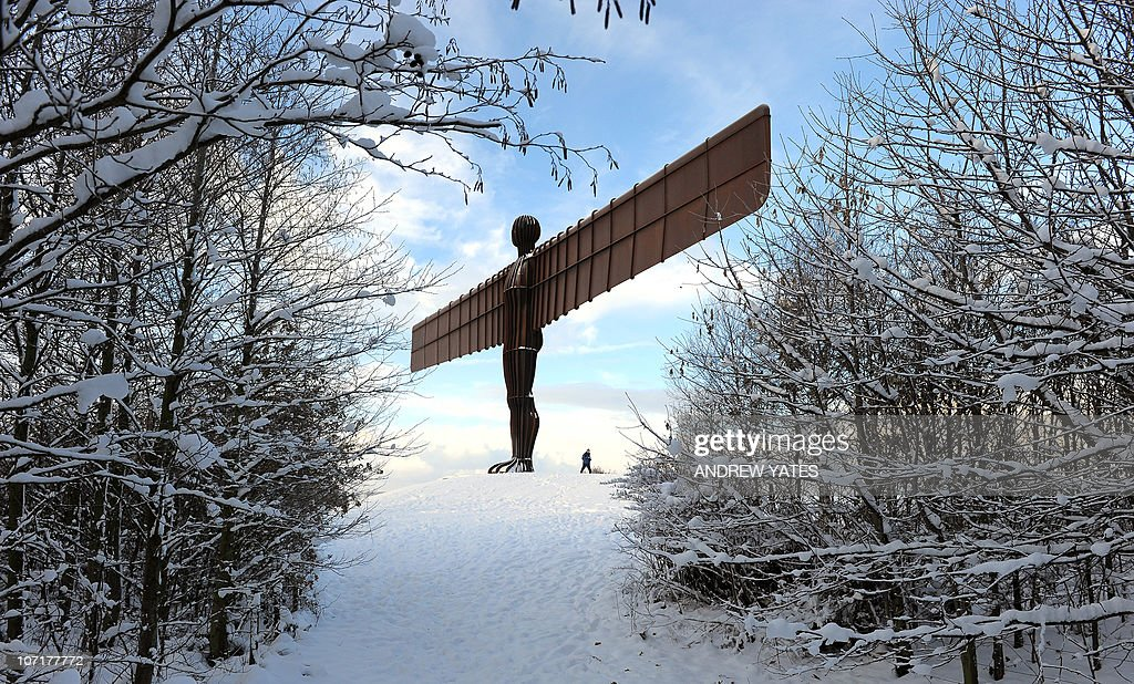 The landmark sculpture entitled 'Angel of the North' by British artist Antony Gormley stands amongst snow near Gateshead, in north-east England, on November 28, 2010 . Parts of Britain were blanketed in up to 35 centimetres (13 inches) of snow, causing air and road disruption, in the earliest widespread snowfall for 17 years.