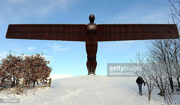 The landmark sculpture entitled 'Angel of the North' by British artist Antony Gormley stands amongst snow near Gateshead, in north-east England, on...
