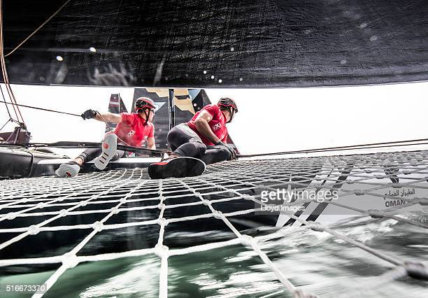 The LandRover BAR Academy GC32 foiling catamaran skippered by Bleddyn Mon  race during The Extreme Sailing Series 2016 March 18 2016 in Muscat Oman