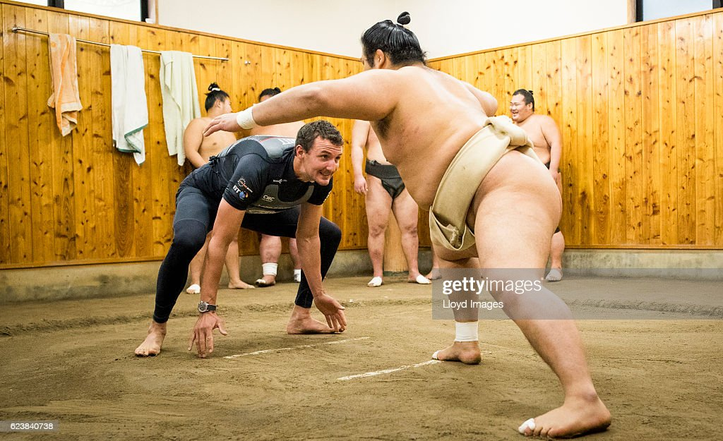 The LandRover BAR British Americas Cup Team Tactician Giles Scott visits the Kokonoe Beya Sumo Stable, prior to the start of racing during the Louis Vuitton Americas Cup World Series Japan on November 17, 2016 in Fukuoka, Japan.