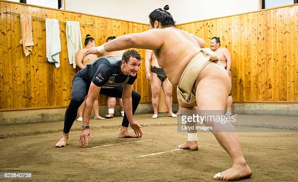 The LandRover BAR British Americas Cup Team Tactician Giles Scott visits the Kokonoe Beya Sumo Stable prior to the start of racing during the Louis...