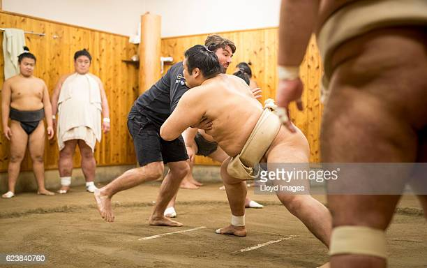 The LandRover BAR British Americas Cup Team team manager Jono McBeath visits the Kokonoe Beya Sumo Stable prior to the start of racing during the...