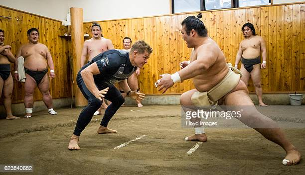 The LandRover BAR British Americas Cup Team trimmer David Carr visits the Kokonoe Beya Sumo Stable prior to the start of racing during the Louis...