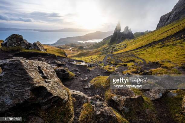 the landscape around the old man of storr and the storr cliffs, isle of skye scotland, united kingdom - scotland imagens e fotografias de stock