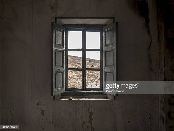 The landscape is seen through the window of an abandoned house in the village of Selas on February 26 2015 near Molina de Aragon Spain The process of...
