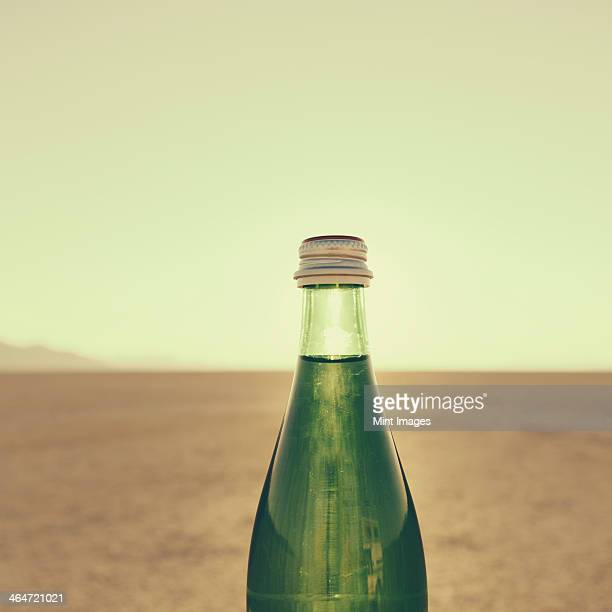 The landscape of the Black Rock Desert in Nevada. An essential element for survival. A bottle of water. Filtered mineral water.