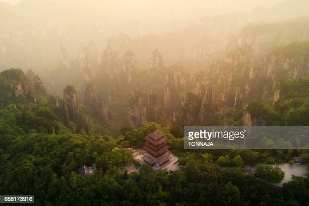 The Landscape of Zhangjiajie National Forest Park and red Chinese temple, Hunan, China