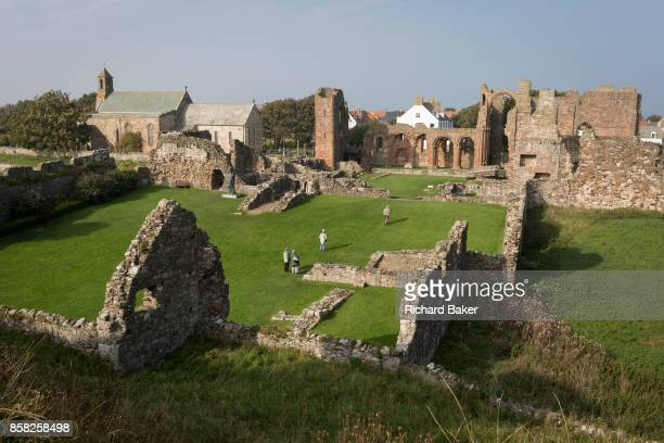 The landscape surrounding the early 12th century Lindisfarne Priory on Holy Island, on 27th September 2017, on Lindisfarne Island, Northumberland,...