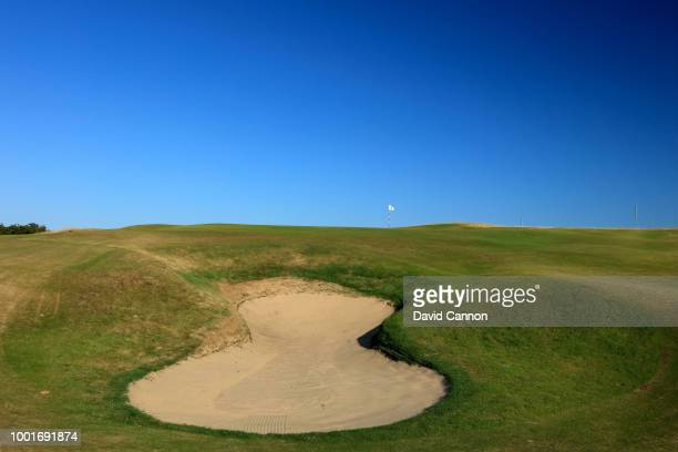 The large bunker front left of the elevated green on the 416 yards par 4 first hole on the Dunluce Links at Royal Portrush Golf Club the venue for...