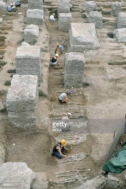 The large burial trench under excavation at the Royal Mint site from the Black Death cemetery East Smithfield London Burials were carefully though...