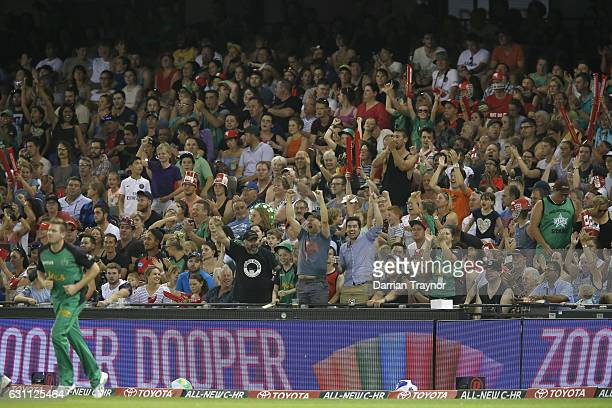 The large crowd cheers as James Faulkner of the Melbourne Stars takes a catch to dismiss Cameron White of the Melbourne Renegades during the Big Bash...
