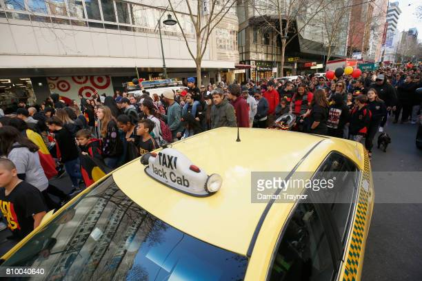 THe large crowd march down Burke Street during the 2017 NAIDOC March on July 7 2017 in Melbourne Australia The march was organised to call for a day...