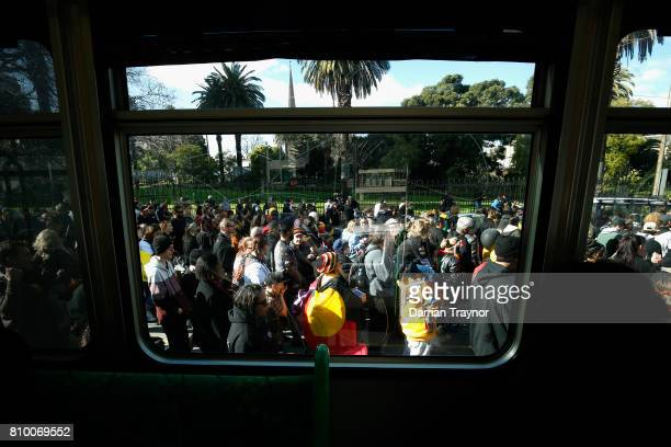 The large crowd marches past trams on Spring Street at the 2017 NAIDOC March on July 7 2017 in Melbourne Australia The march was organised to call...