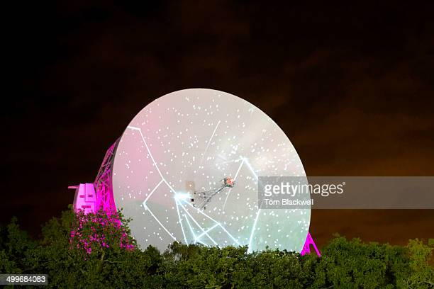 The large dish of the Lovell Telescope, which usually studies radio signals from space, is seen here entertaining pleasure-seekers with illuminations...