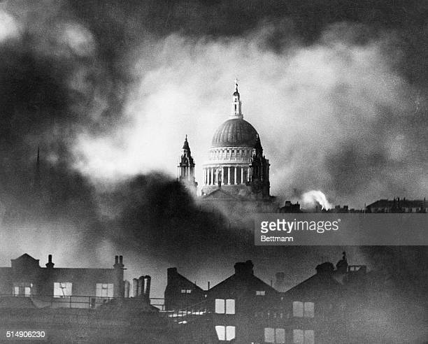 The large dome of St Paul's Cathedral is wreathed in smoke from buildings burning after a German air raid in World War II